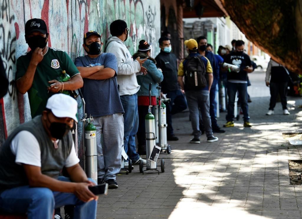 People line up to refill oxygen tanks in Mexico City