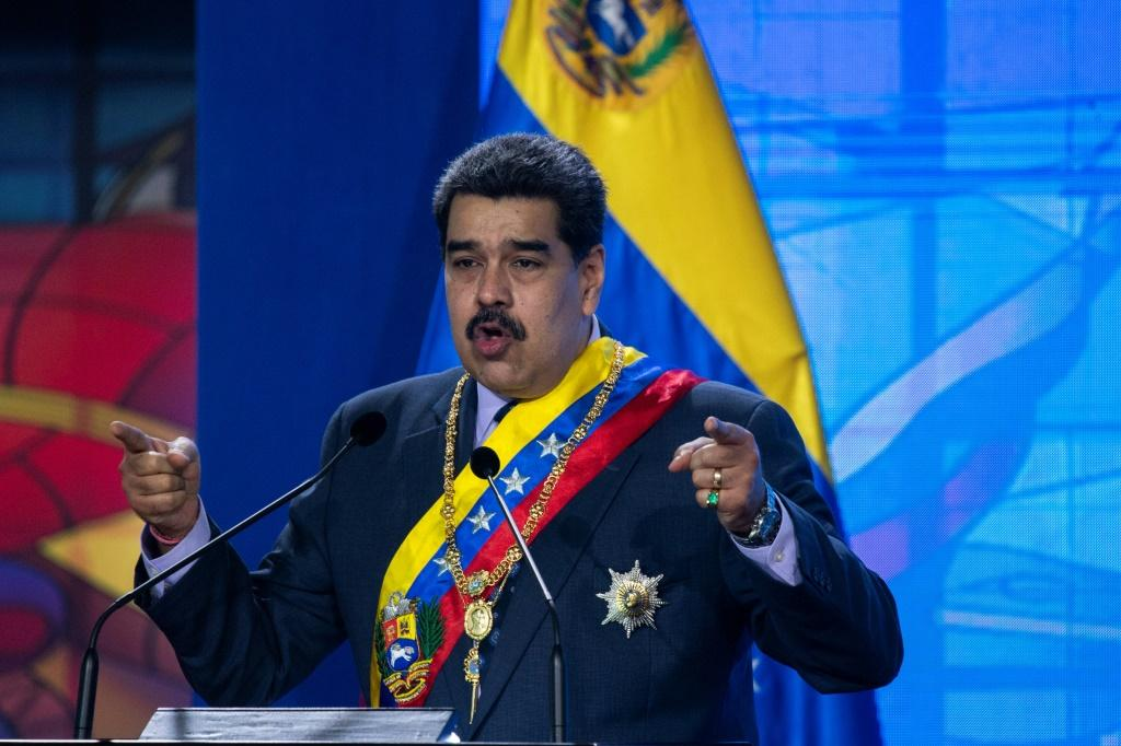 """Venezuelan President Nicolas Maduro, pictured here delivering a speech on January 22, 2021, says he """"is willing to turn the page"""" with the new US administration of President Joe Biden"""
