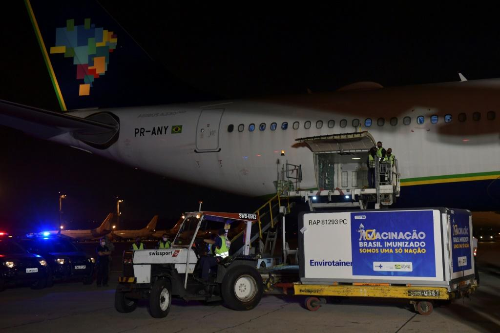 A shipment of the AstraZeneca/Oxford vaccine is unloaded from a cargo plane arriving from India on January 22, 2021 at Guarulhos airport near Sao Paulo, Brazil