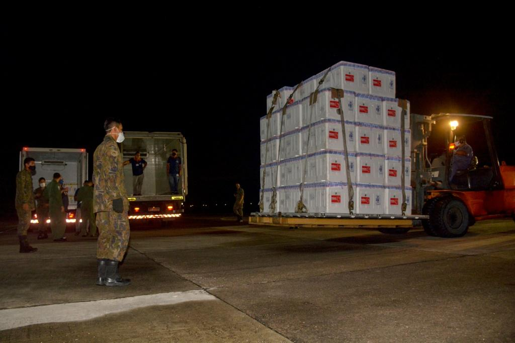 Boxes containing doses of the CoronaVac vaccine arrive in Manaus, Brazil, on January 18, 2021