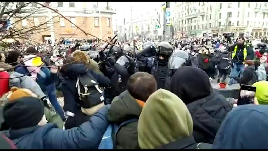 Officers detain protesters at a demonstration in Moscow in support of prominent Kremlin critic Alexei Navalny. He called the demonstrations after he was detained returning to Russia from Germany where he had been recovering from being poisoned with a Sovi