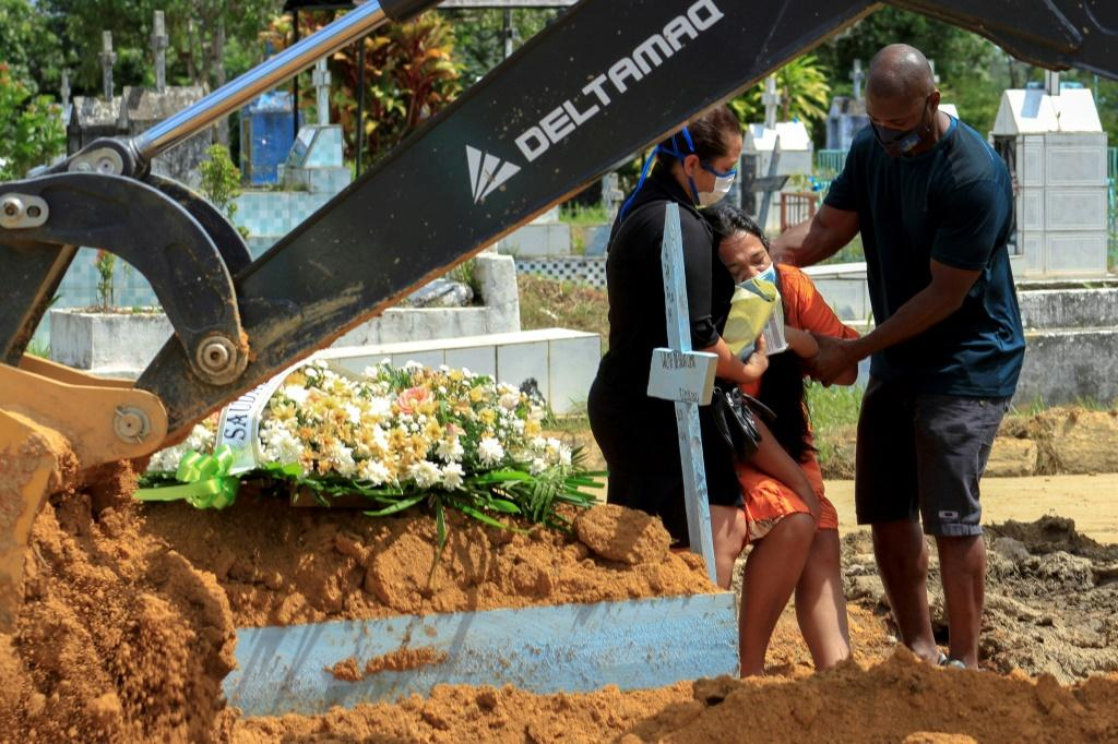 Relatives of a Covid-19 victim mourn during a funeral at a cemetery in the hard-hit Brazilian city of Manaus, in Amazonas state, on January 22, 2021