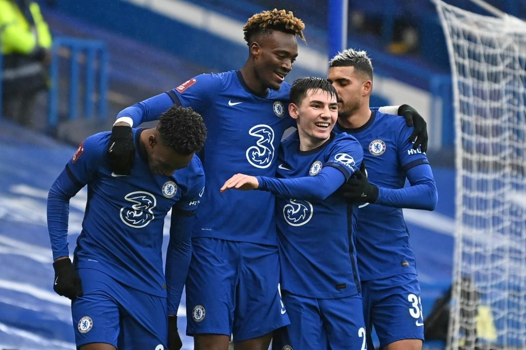Three and easy: Tammy Abraham (second left) scored a hat-trick in Chelsea's 3-1 win over Luton