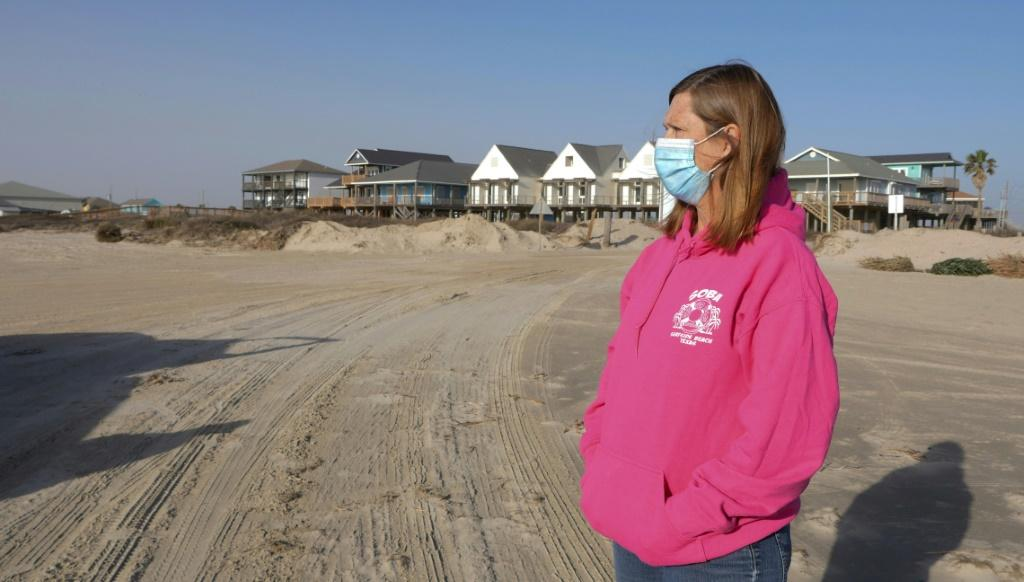 Toni Capretta, president of the Save Our Beach association, looks on during Dunes Day at Surfside Beach, Texas, on January 16, 2021