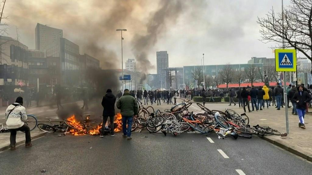 Police use tear gas and protesters throw rocks in the Dutch city of Eindhoven after a demonstration against a new curfew to curb the spread of Covid-19 in the Netherlands degenerated into clashes.