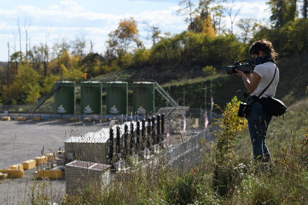 Environmental activist Leann Leiter uses an infrared camera to look for invisible emissions from the Mad Dog 2020 fracking site in Pennsylvania