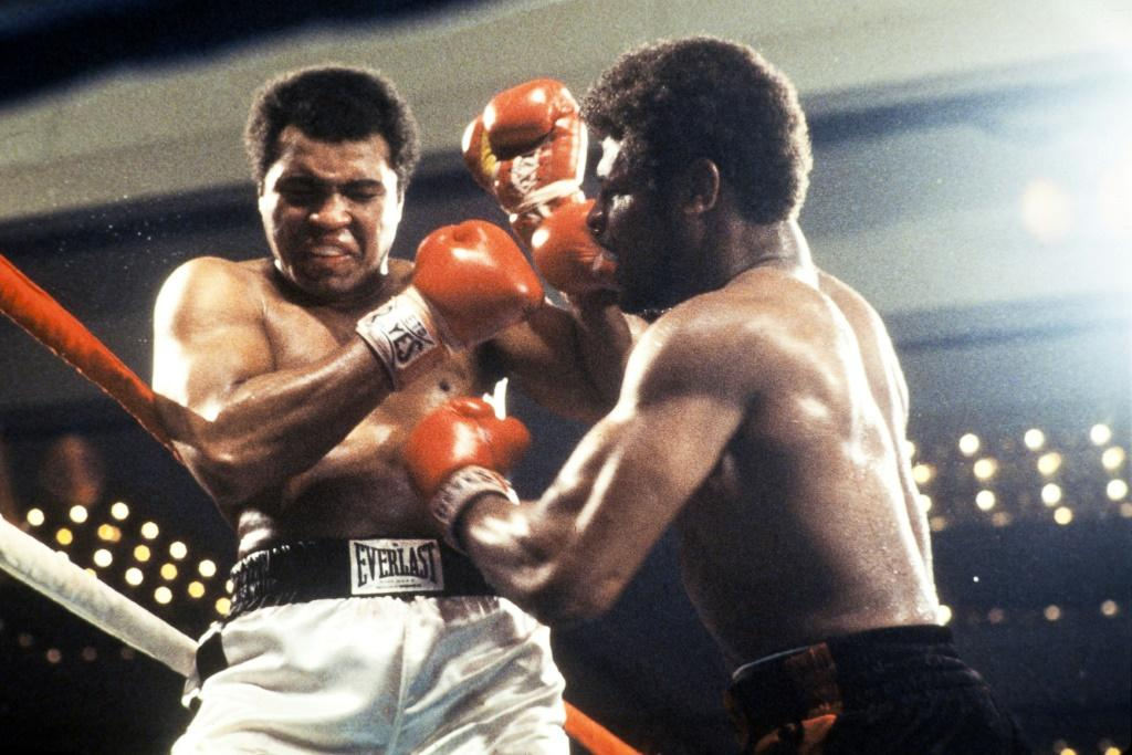 Leon Spinks, who died Friday at age 67, is shown at right in the 1978 fight at Las Vegas where he defeated reigning champion Muhammad Ali, left, for the world heavyweight boxing championship