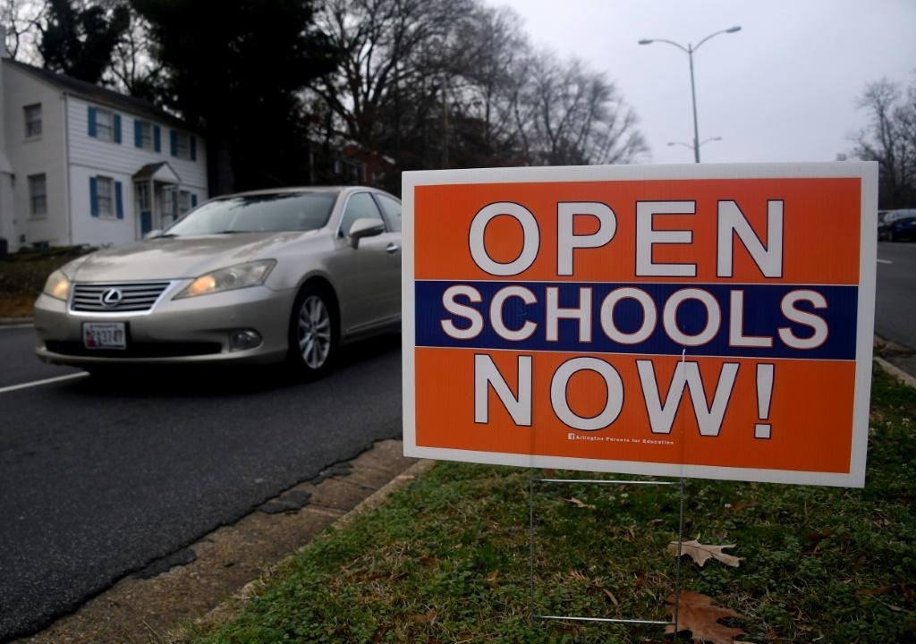 A sign calling for schools to reopen in Arlington, Virginia, pictured in December 2020