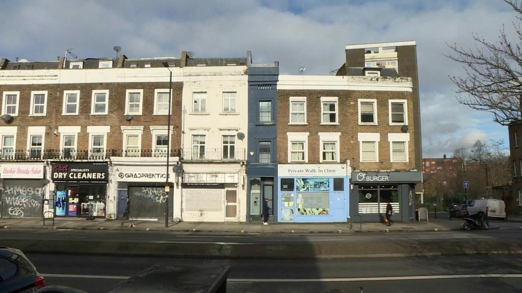 Blink and you could easily miss it. Wedged between a doctor's surgery and a hairdressing salon, London's thinnest house is only identified by a streak of dark blue paint. But the five-floor house in Shepherd's Bush -- which is just 5ft 6ins (1.6 metres) a