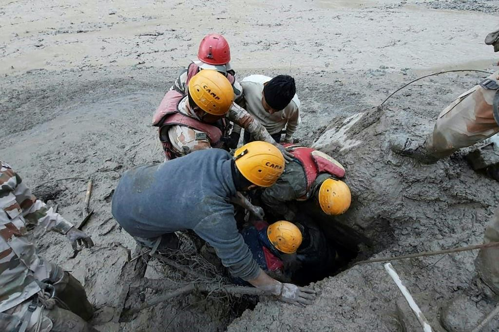 Rescuers at work after a broken glacier caused a river surge that swept away bridges and roads in the Chamoli district of Uttarakhand, northern India