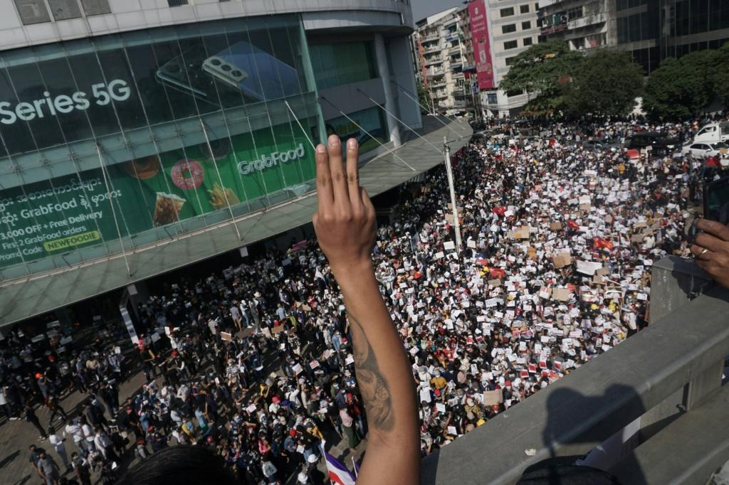 The three-finger salute has become the trademark sign of protesters in Myanmar