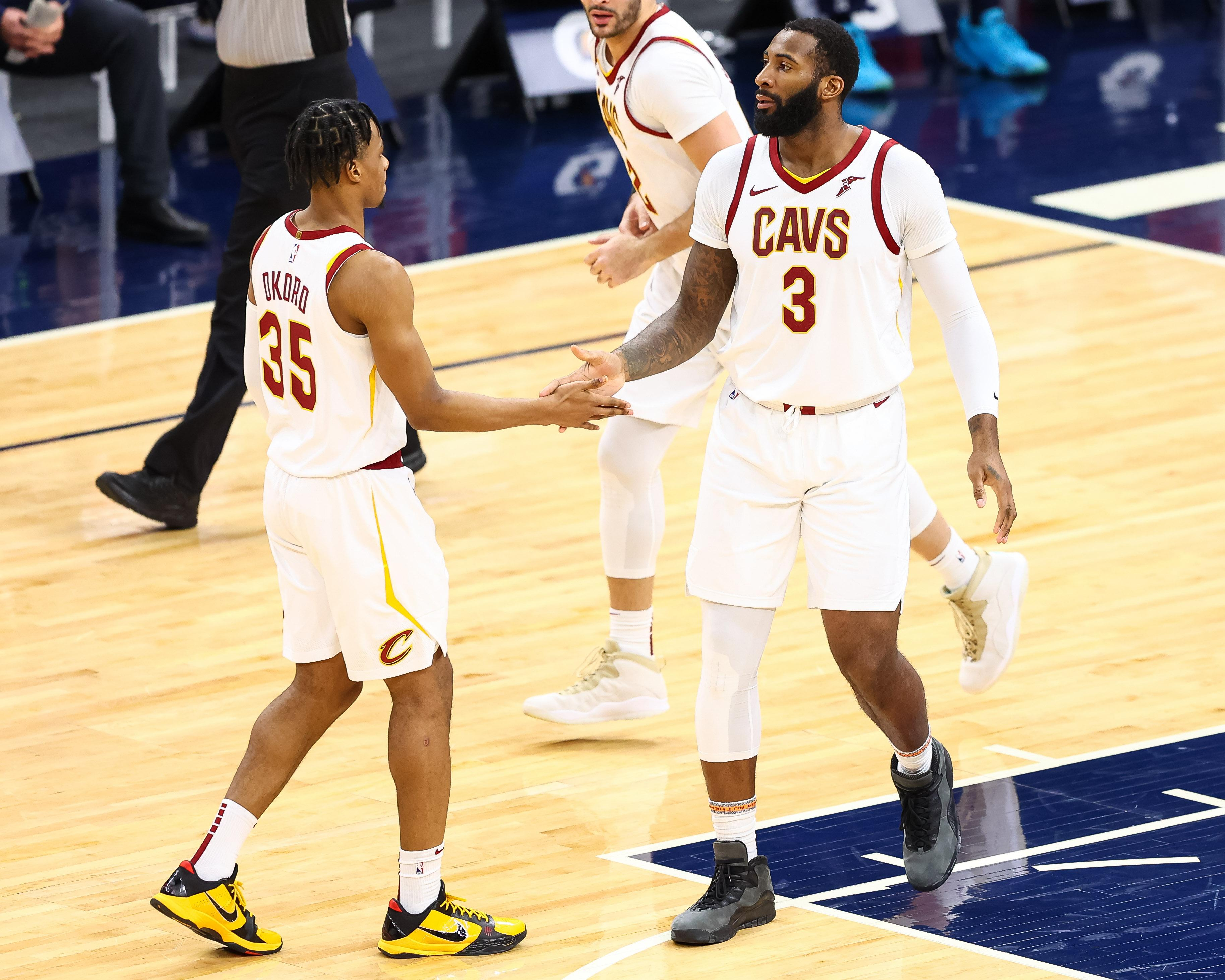 Andre Drummond #3 and Isaac Okoro #35 of the Cleveland Cavaliers