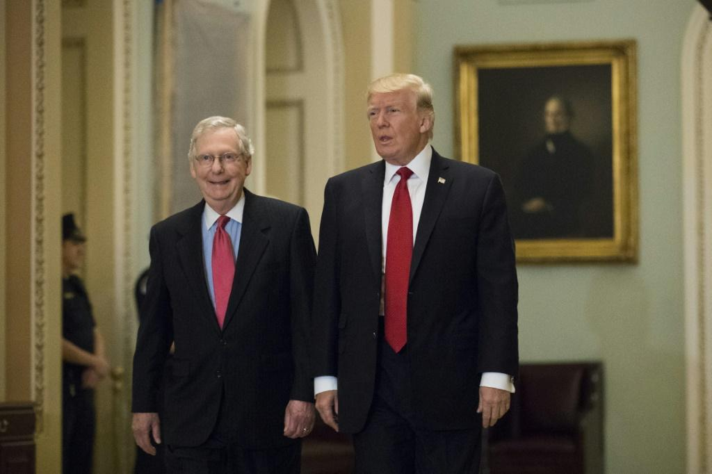 Better days: then-president Donald Trump (R) and Mitch McConnell, the powerful Senate majority leader at the time, in October 2017.