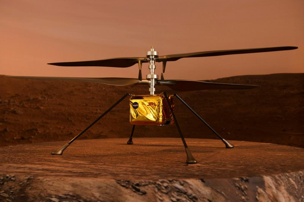 A full scale model of the experimental Ingenuity Mars Helicopter, which will be carried under the Mars 2020 Perseverance rover, is displayed at NASA's Jet Propulsion Laboratory