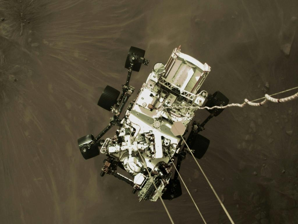 "The high-resolution still was extracted from a video taken by the descent stage, which at that moment had used its six-engined jetpack to slow to a speed of about 1.7 miles (2.7 kilometers) per hour as part of the ""skycrane maneuver"