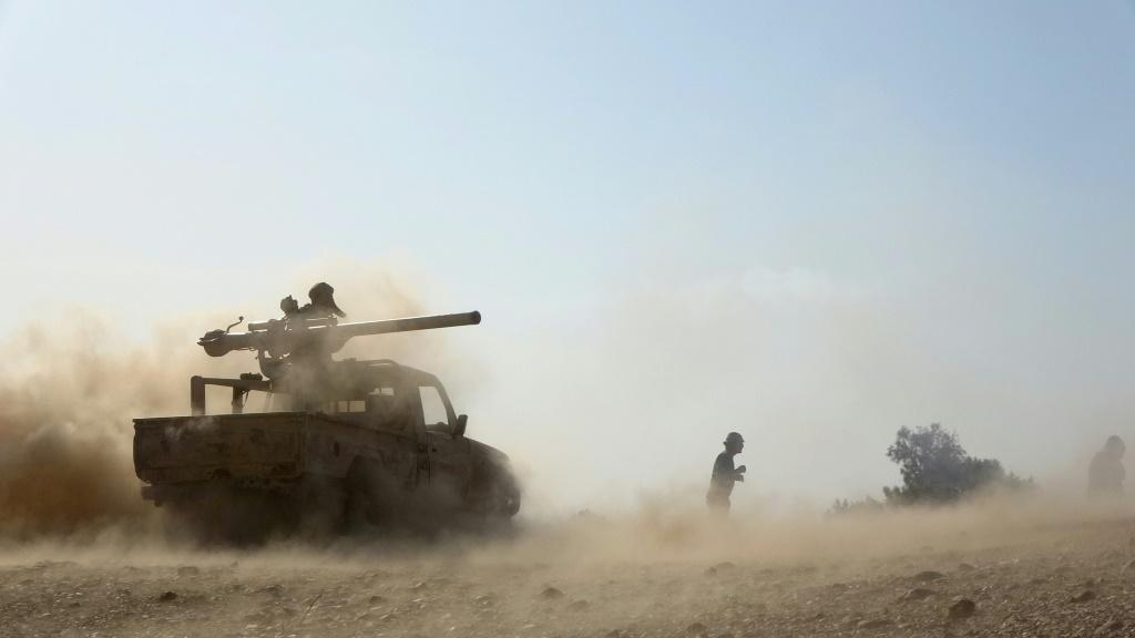 Fighters loyal to Yemen's Saudi-backed government resist a renewed Huthi rebel assault on the strategic city of Marib in the desert east of the rebel-held capital