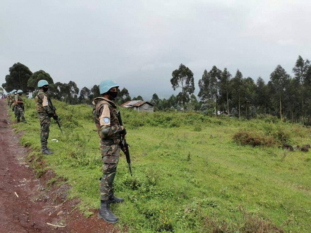 Moroccan troops with the UN peacekeeping mission MONUSCO deployed on a road in the Kibumba area in the Virunga National Park, 25 kilometres (15 miles) from Goma, after the attack