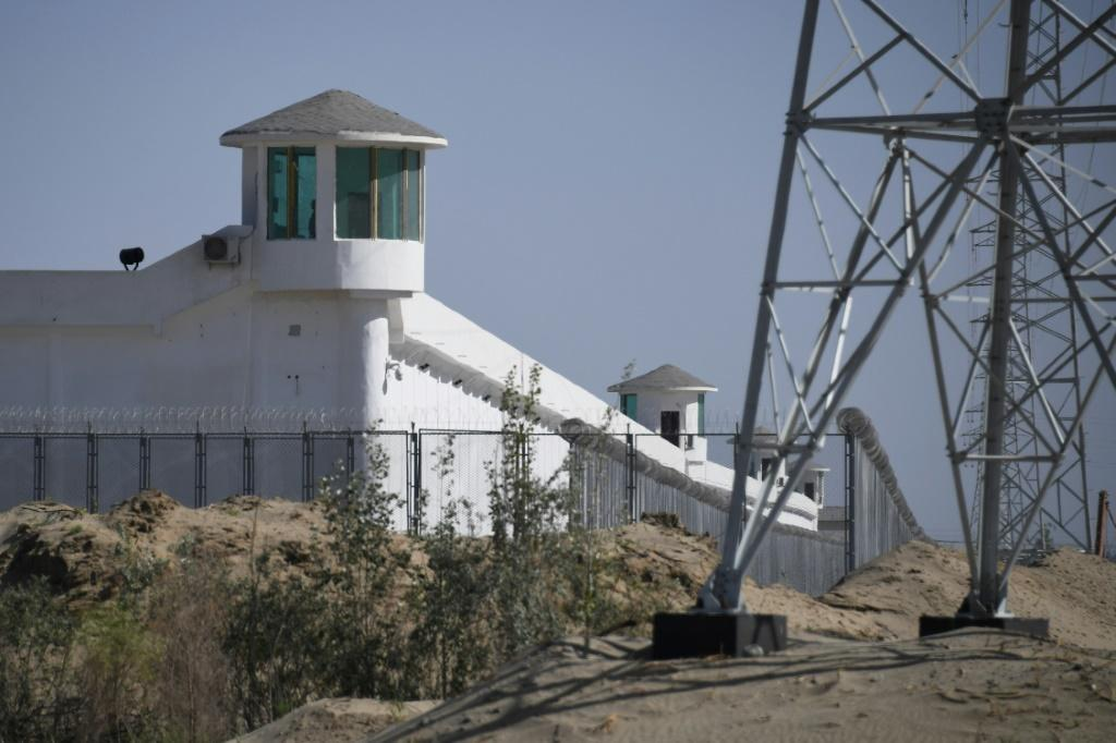 This photo taken on May 31, 2019 shows watchtowers on a high-security facility near what is believed to be a re-education camp where mostly Muslim ethnic minorities are detained, on the outskirts of Hotan, in China's northwestern Xinjiang region