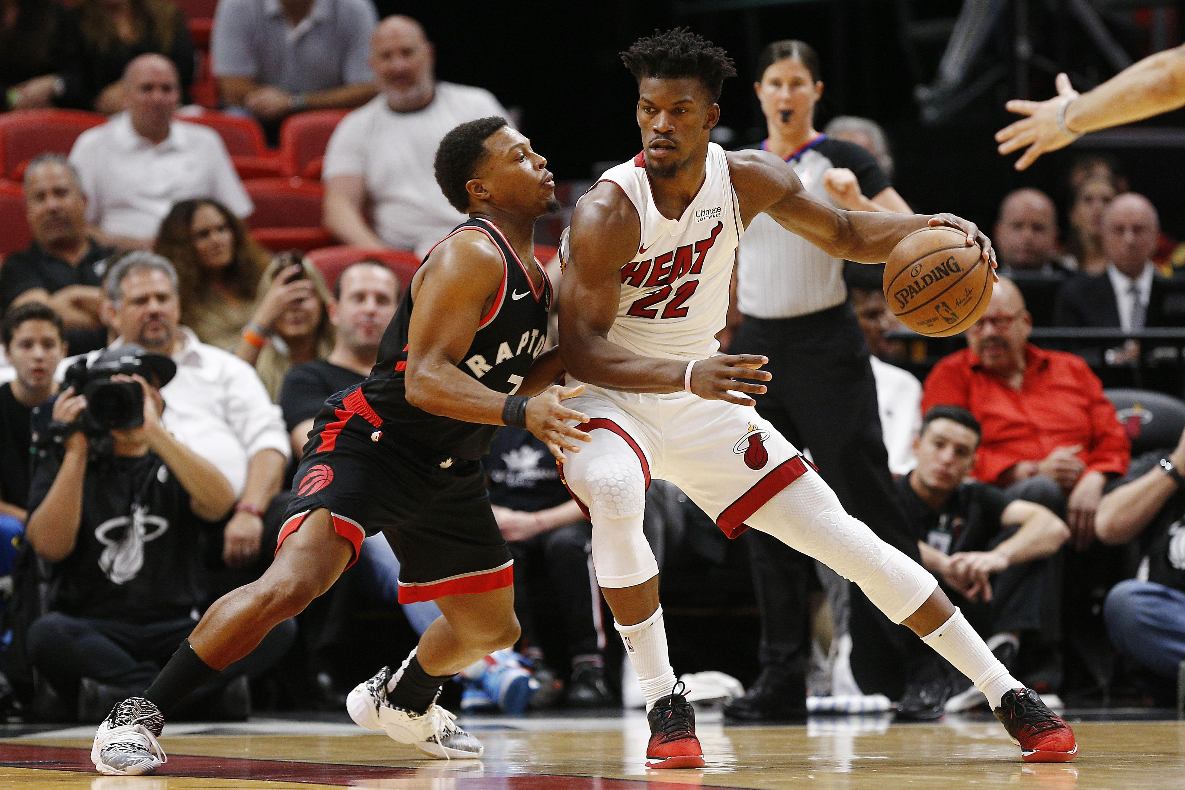 Jimmy Butler #22 of the Miami Heat drives to the basket against Kyle Lowry #7 of the Toronto Raptors