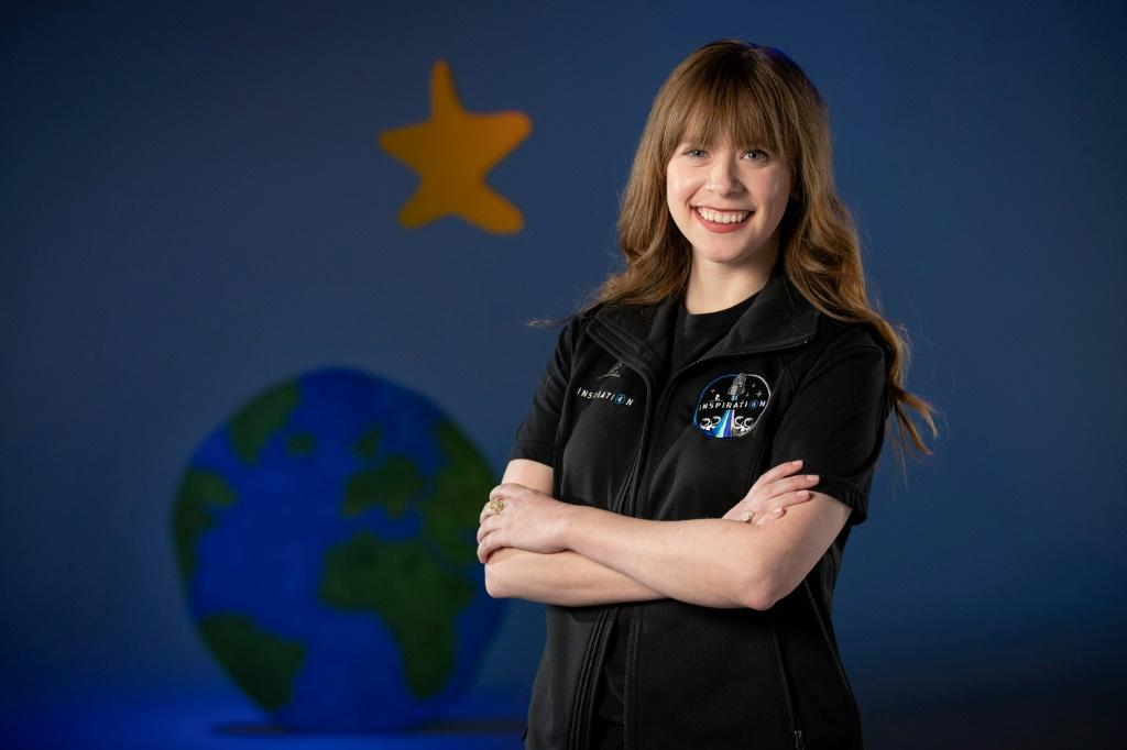 This undated photo courtesy of ALSAC received by AFP on February 22, 2021, shows St. Jude Children's Research Hospital's physician assistant and cancer survivor Hayley Arceneaux, posing for a photo when visiting a SpaceX facility in Hawthorne, California