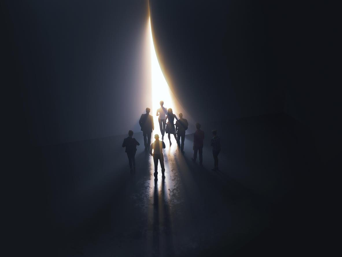 People at the door leading to the light - Social Capital
