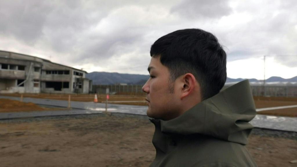 Yuto Naganuma looks silently as the cold sea breeze sweeps over the crumbling walls of the school where his little brother was lost in Japan's devastating 2011 tsunami. Ten years on, Naganuma and others like him form a generation whose young lives were s