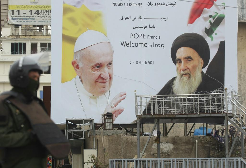 A billboard celebrates the meeting between Pope Francis and Grand Ayatollah Ali Sistani on the pontiff's second day of his historic visit to Iraq