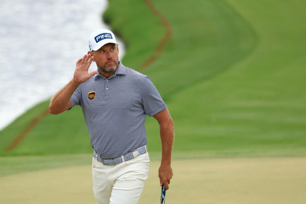 England's Lee Westwood celebrates a birdie at the 18th hole that gave him a one-stroke lead after saturday's third round of the US PGA Arnold Palmer Invitational
