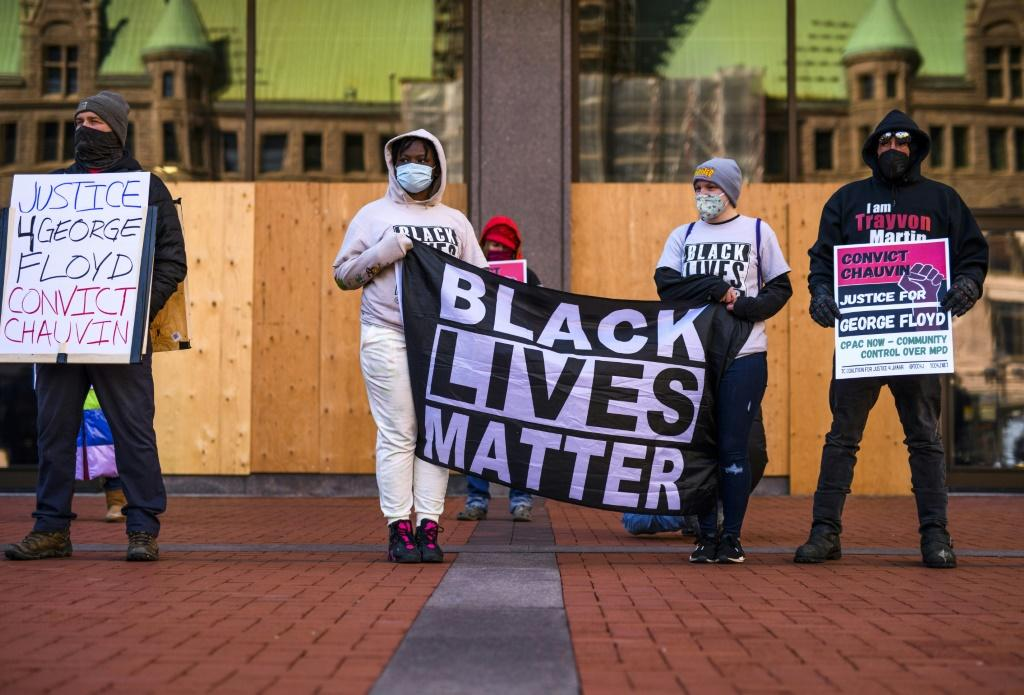 """Black Lives Matter"""" protestors in Minneapolis, Minnesota ahead of the trial of the police officer charged with killing George Floyd"""