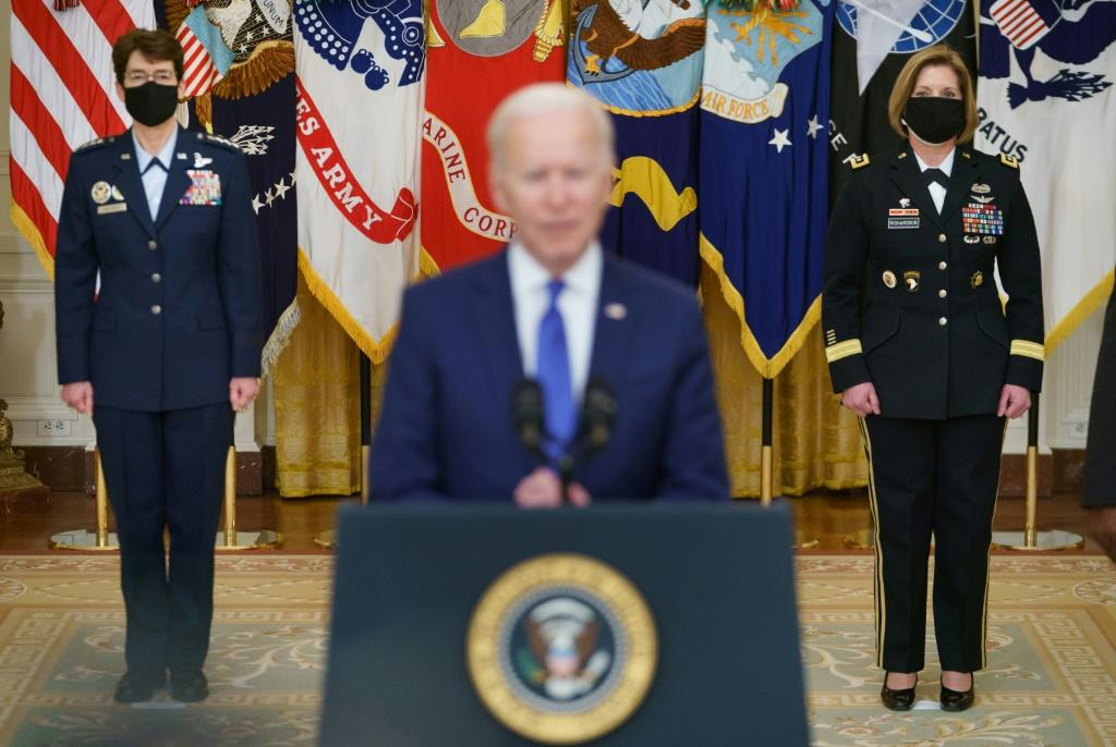 President Joe Biden introduces generals Jacqueline Van Ovost (L) and Laura Richardson (R), who have been nominated to lead US military commands, at the White House in Washington, DC