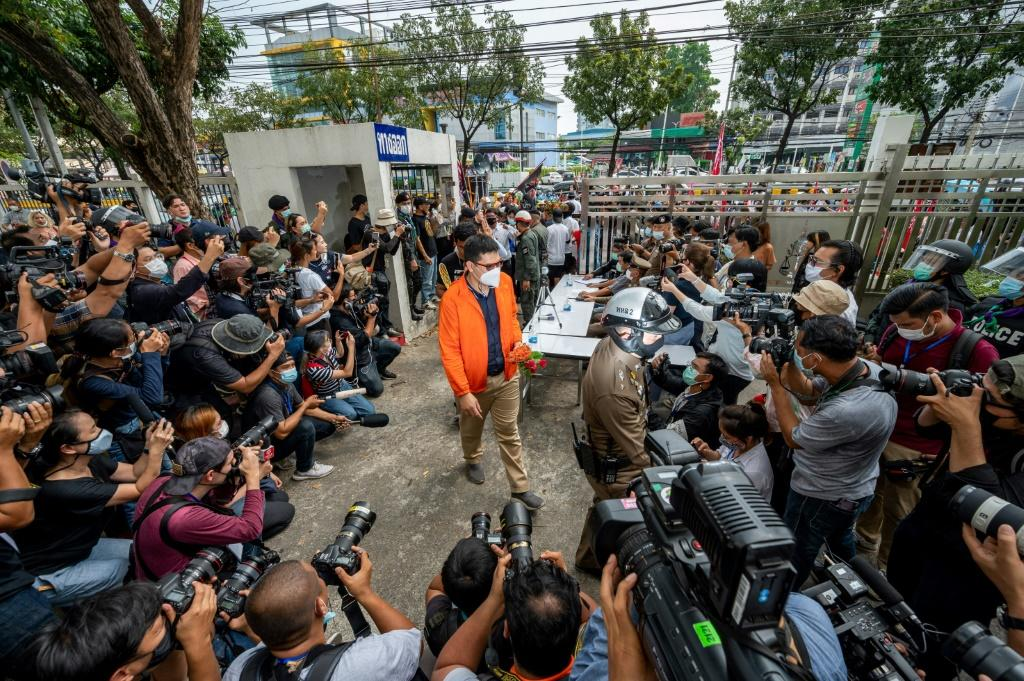 The activists marched to a Bangkok criminal court Monday morning flanked by scores of supporters carrying posters of other detained protest leaders and flags
