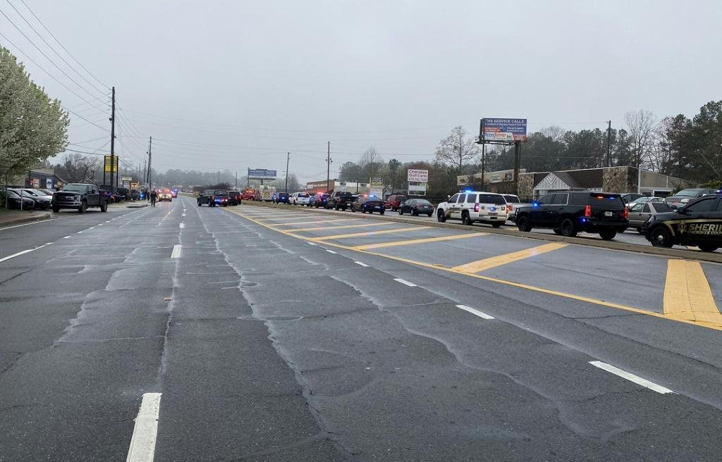 Law enforcement cars block the area of a shooting at a spa in an Atlanta suburb