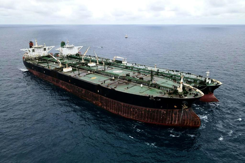 A seized Iranian tanker and Panamanian vessel suspected of illegally transferring oil to Indonesian waters.