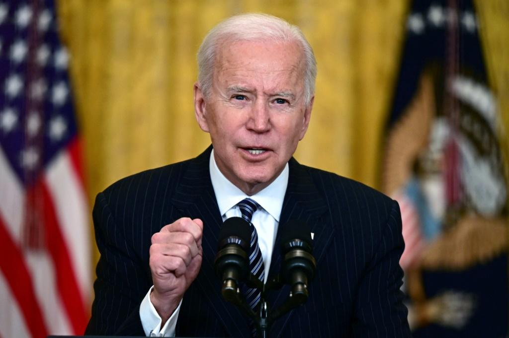 Joe Biden told Americans now was a time for 'optimism' but not 'relaxation' as the US prepared to administer its 100 millionth vaccine