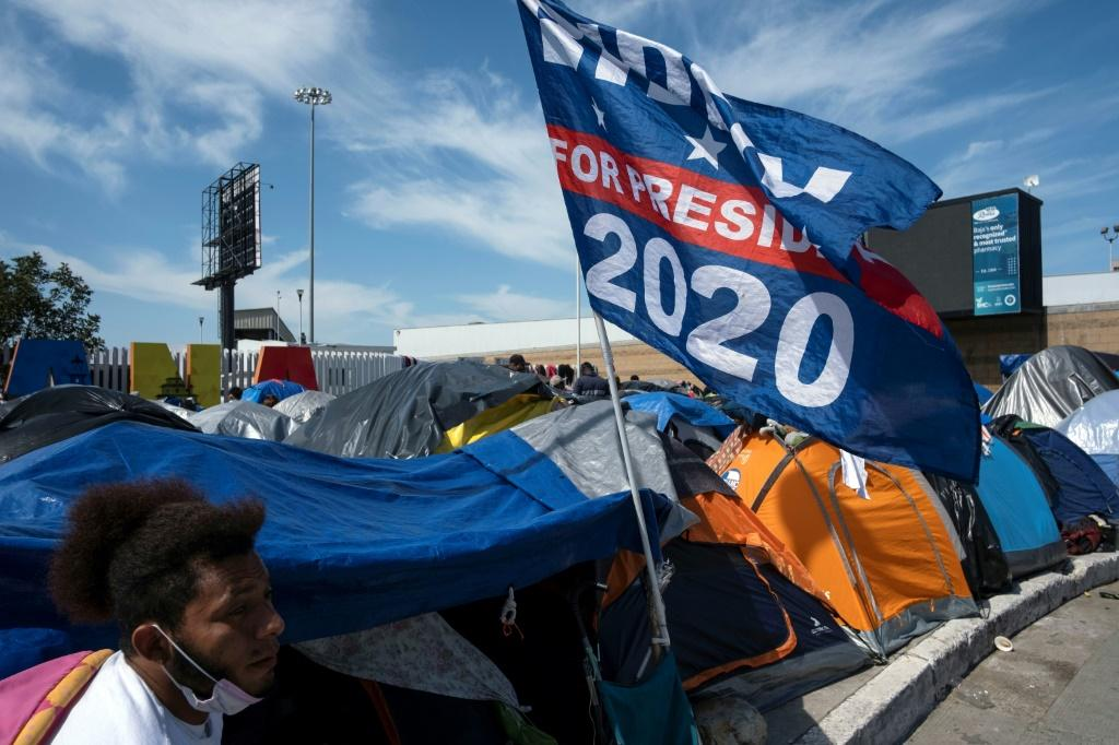 Joe Biden's campaign flag is seen at a migrant camp in Tijuana on the US-Mexico border
