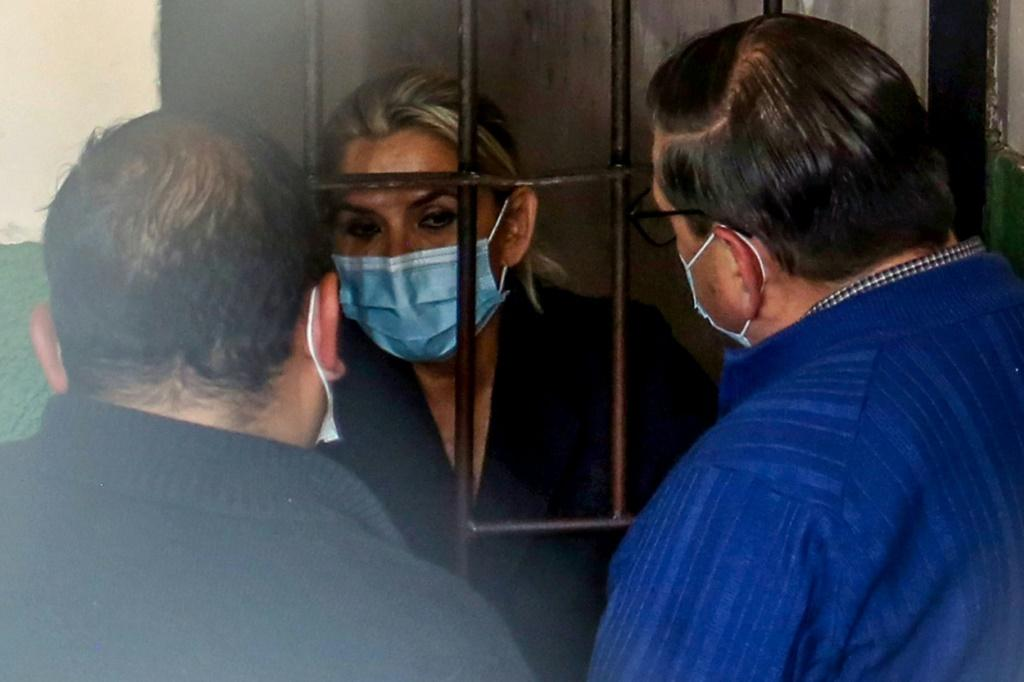 Bolivia's former interim president Jeanine Anez speaks with her lawyers from a jail cell on March 13, 2021