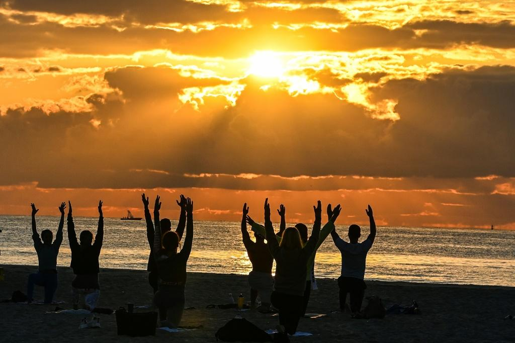 A yoga session in Miami Beach, Florida -- a stark contrast to the late-night party scene that has forced police to impose a curfew