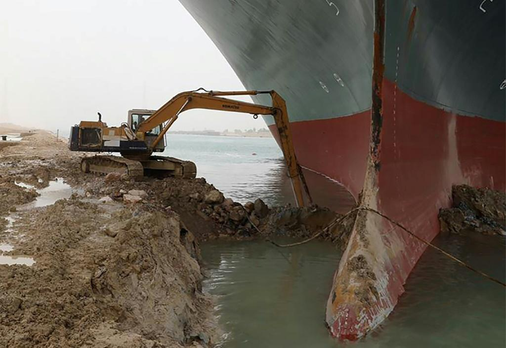 An excavator is used to dig out the MV Ever Given, a 400-metre- (1,300-foot) long vessel lodged across Egypt's Suez Canal