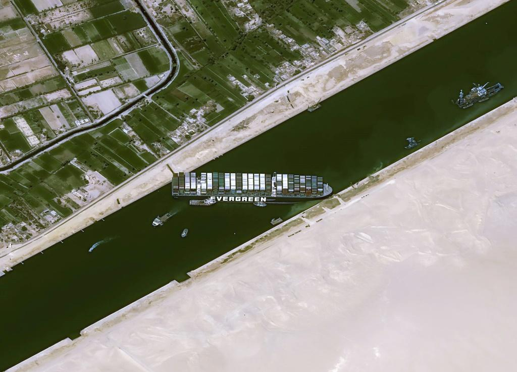 The Taiwan-run MV Ever Given container ship is lodged sideways and impeding all traffic across the Egypt's Suez Canal
