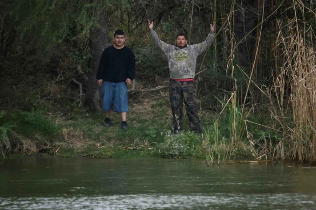 'Polleros,' as the human traffickers are known in Mexico, prepare to cross the Rio Grande into Texas on March 28 2021