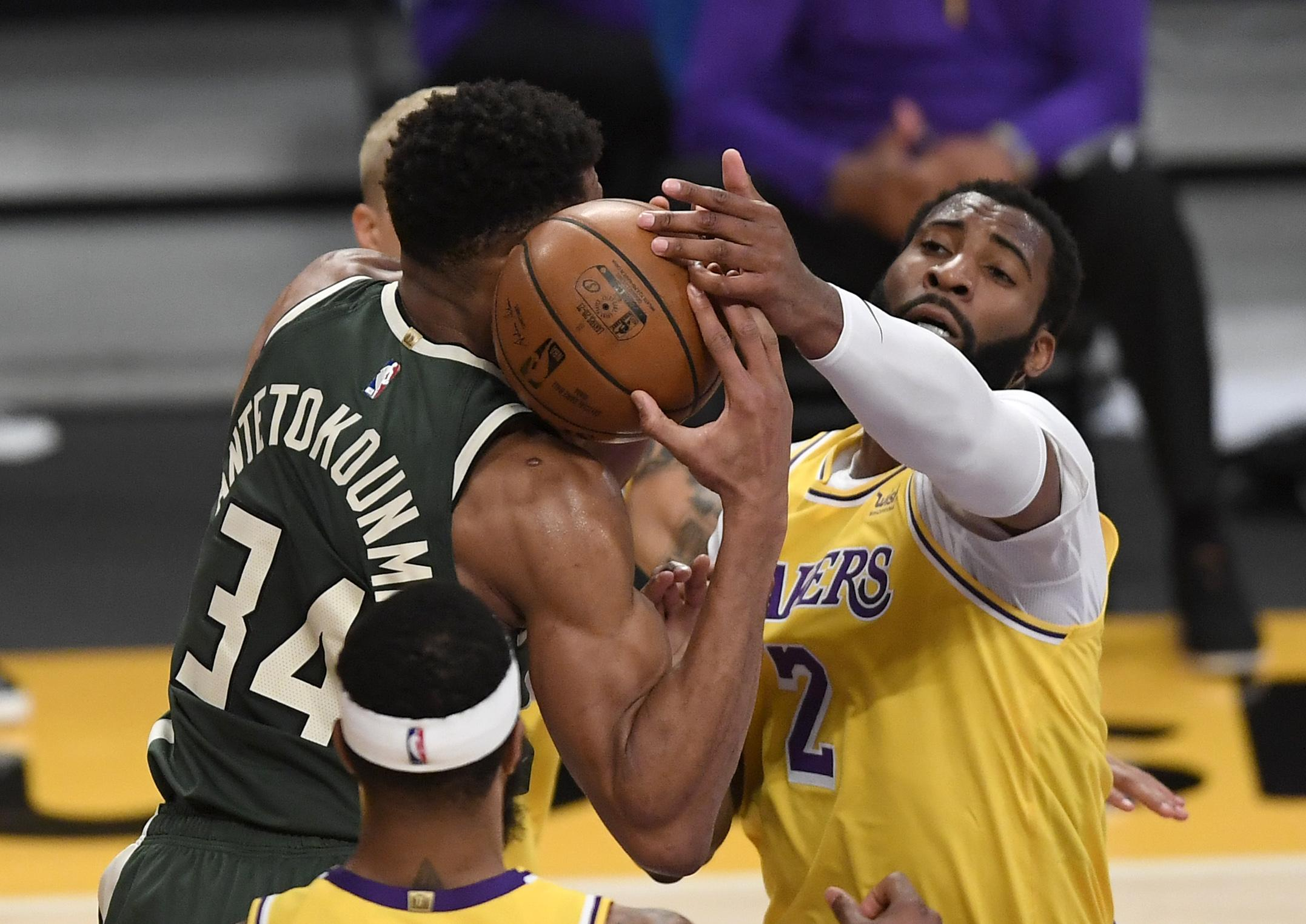 Andre Drummond #2, making his debut with the Los Angeles Lakers, and Giannis Antetokounmpo #34 of the Milwaukee Bucks Andre Drummond #2, making his debut with the Los Angeles Lakers, and Giannis Antetokounmpo #34 of the Milwaukee Bucks