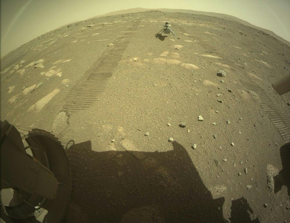 Ingenuity (shown on the surface of Mars behind the Perseverance rover) will perform tests of its rotors and motors over the coming days ahead of its first flight attempt, scheduled no earlier than April 11