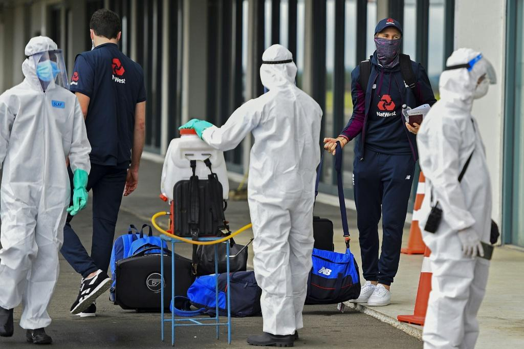 England captain Joe Root (second right) and teammates arrive in a bio-secure bubble for the their tour of Sri Lanka and India earlier this year