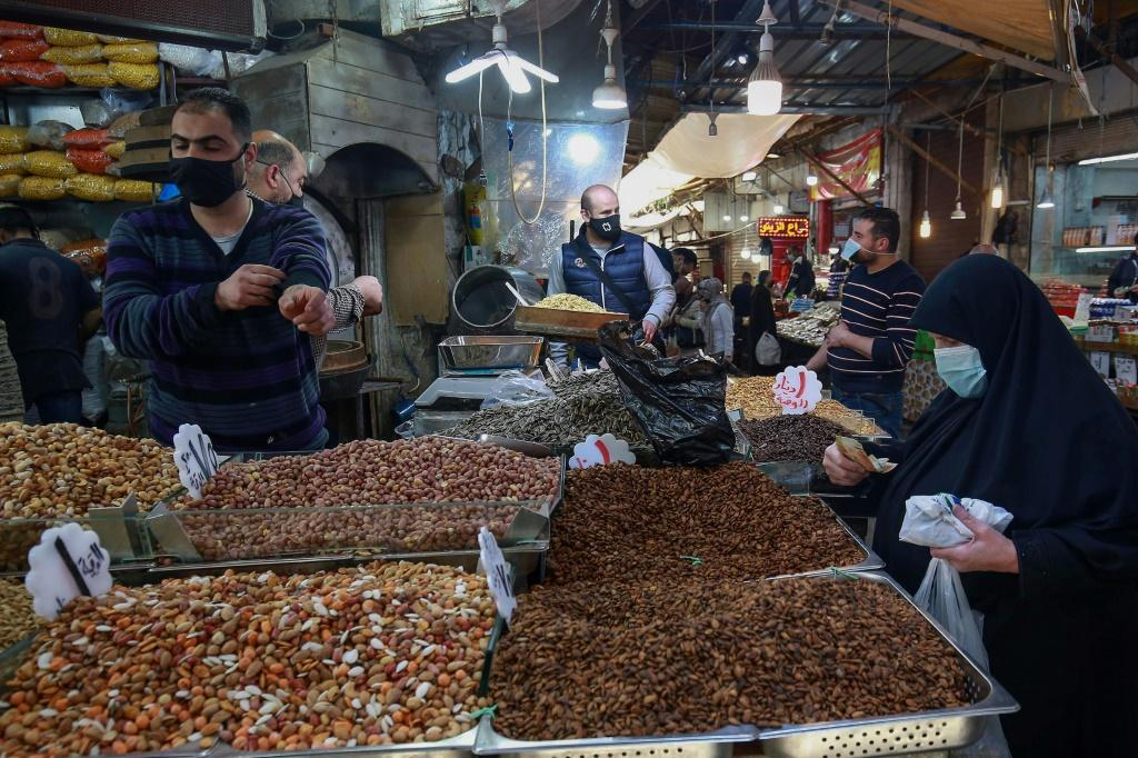 People shop in Jordan's capital Amman on April 5; ordinary Jordanians say a reporting blackout on matters of the royal family mean they hear little news on the matter