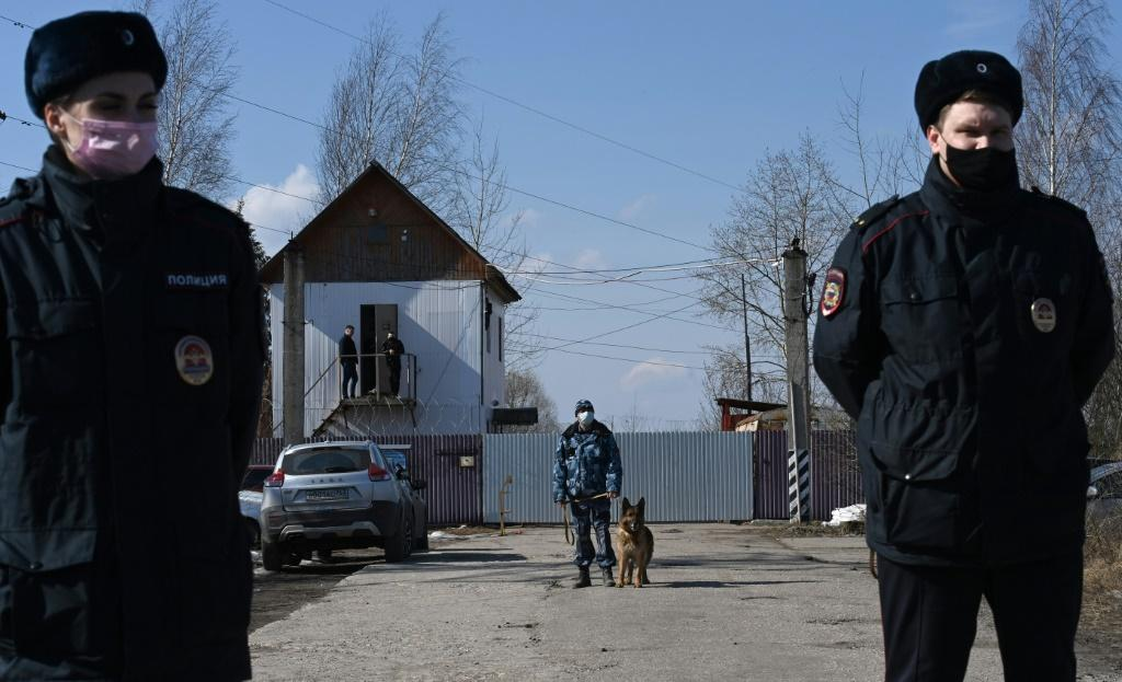 Russian police officers guard at the penal colony N2, where Kremlin critic Alexei Navalny is serving a two-and-a-half year prison term