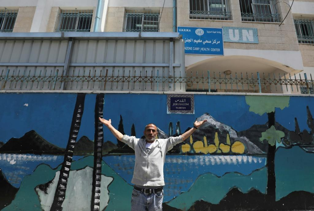 A Palestinian gestures outside a United Nations health centre in the Palestinian refugee camp of Al-Jalazoun near Ramallah on the West Bank