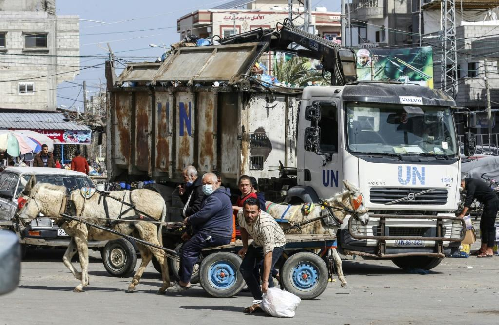 UNRWA workers clean a street at Rafah refugee camp in the Gaza Strip