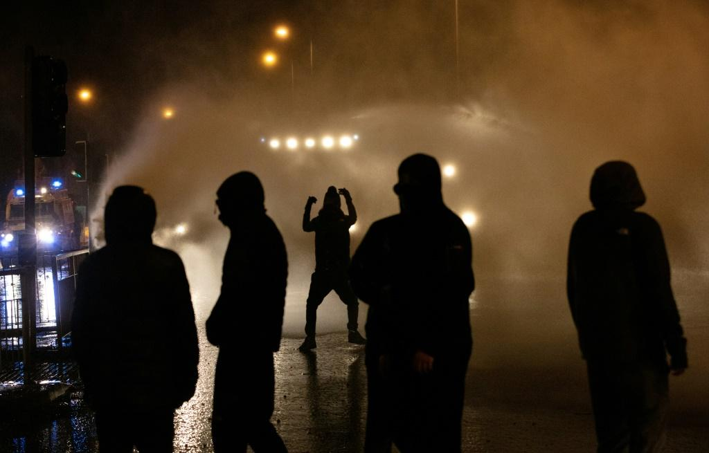 Police deployed a water cannon for the first time in years against rioters in Belfast on Thursday