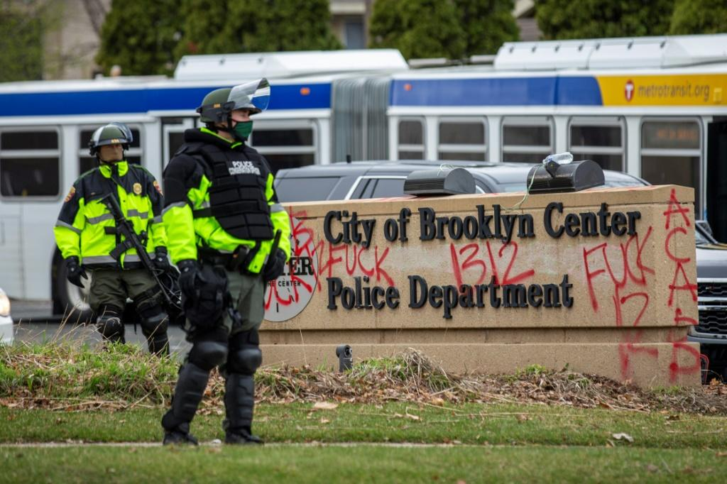 Law enforcement officers stand guard outside the police station in Brooklyn Center, the Minneapolis suburb where the shooting of Daunte Wright took place