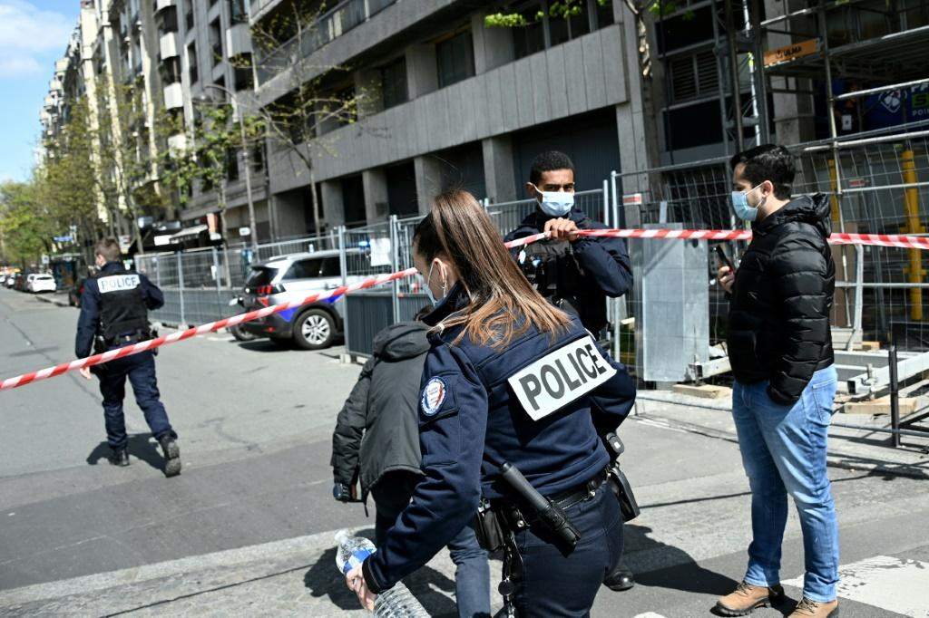 Police cordon off the area outside Paris' Henry Dunant hospital after a fatal shooting